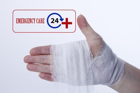 White medical dressing on a traumatized female hand