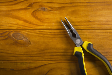 communications tools: Close up of a multitool pliers on wooden background Stock Photo
