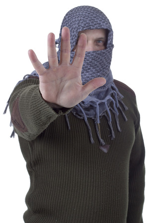 forbid: Arab man gesturing stop with his hand isolated on a white background