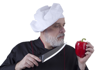 Chef with knife and paprika on white background