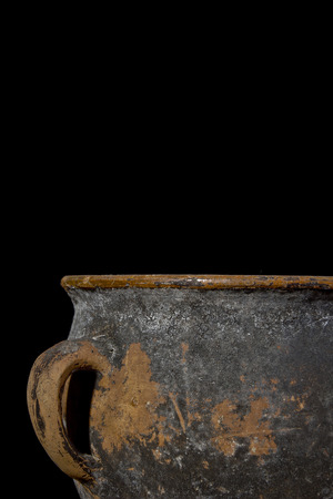Fragment of antique pottery on a black background