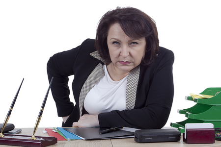 Terrible business woman at the desk on a white background Stock Photo