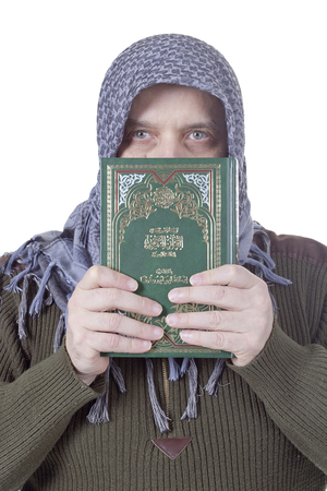 Muslim man with a Quran in hands on a white background photo