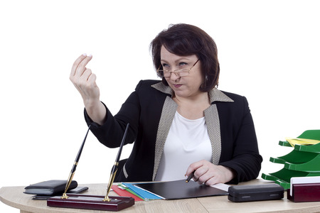 businesswear: Terrible business woman at the desk on a white background Stock Photo