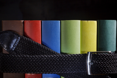 Multicolored book archive pulled by a belt Stock Photo