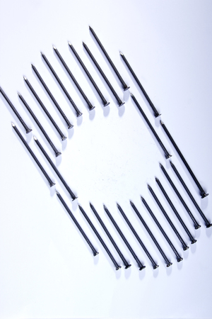 Geometric figure of nails on a white background