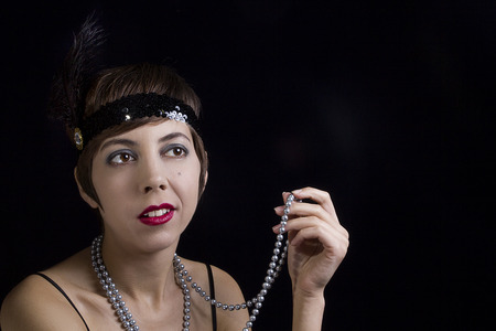 Young woman in the style of the 20s on a black background