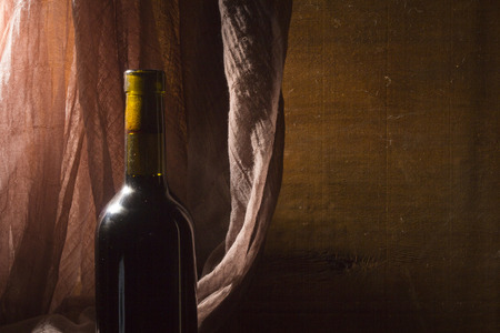 Bottle of red wine on the table Stock Photo