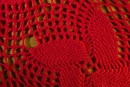 Red knitted shawl close-up in the form of a background Stock Photo
