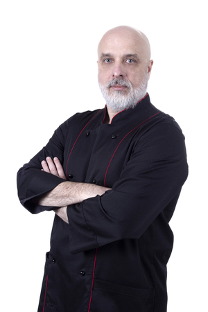 Bearded chef with hands folded over his chest against a white background Stock Photo