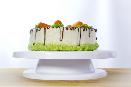 Homemade carrot cake on a white stand