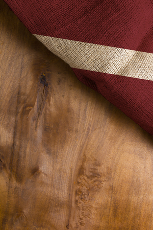 The national flag of Latvia on a wooden surface Foto de archivo - 94718316