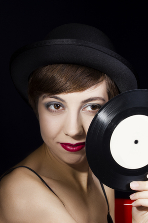 Portrait of a young woman in retro style in a bowler hat Zdjęcie Seryjne
