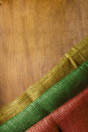 The national flag of Lithuania on a wooden background