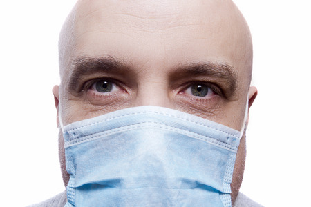 Doctor in gauze mask on white background