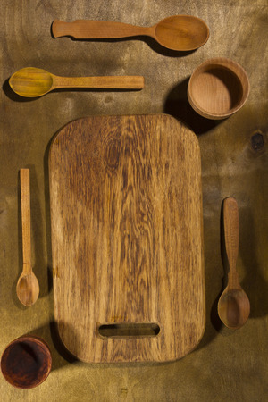 Wooden kitchen accessories on a wooden table