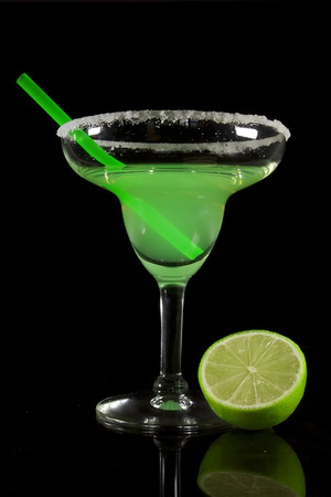 Classic Margarita Cocktail on a Black Reflective Surface