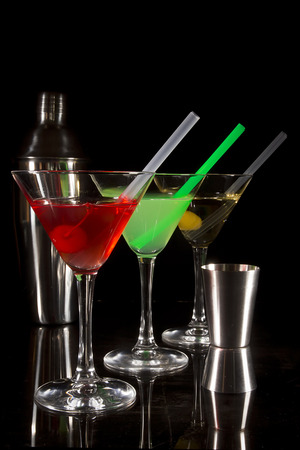 Collection of multi-colored cocktails on a black background Stock Photo