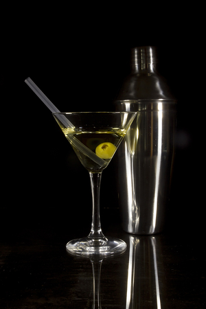 Cocktail and bartender tools on a black reflective background Stock Photo