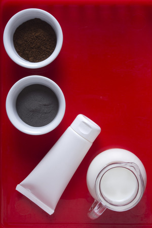 Ingredients for cooking face masks on a red background