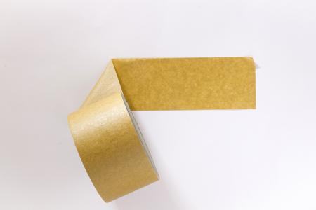 Beige masking tape on a white wall Standard-Bild