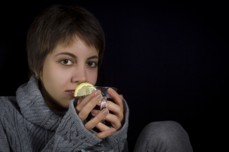 Young woman in a sweater with a hot drink Stock Photo