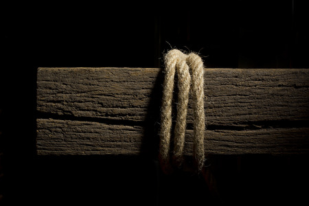 Rope on an old rotten wooden crossbeam