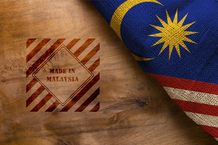 Flag  and symbol made in Malaysia on a wooden surface Archivio Fotografico