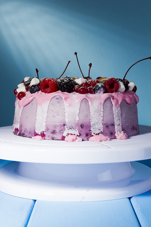 Fruit yoghurt cake on a blue background