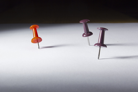 Pins stuck into a blank sheet of paper.