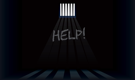 The word help is written on the wall of the prison cell.