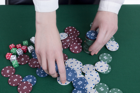 The hands of a croupier at the casino gaming table