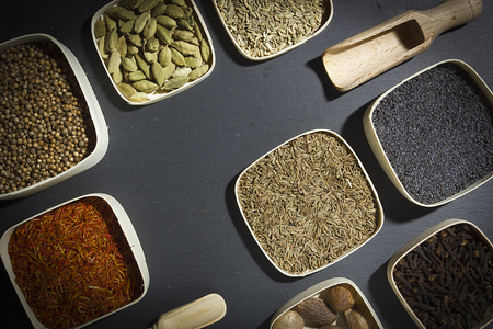 Spice Assortment on a Stone Chopping Board