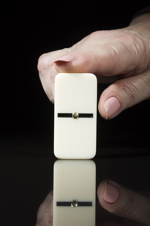 Female finger points to the domino knuckle