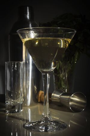 Set of dishes for the bar and a glass of drink Archivio Fotografico - 127760957