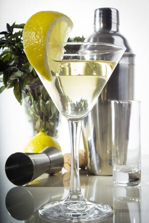 Set of dishes for the bar and a glass of drink Archivio Fotografico - 127760818