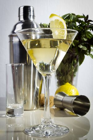 Set of dishes for the bar and a glass of drink Archivio Fotografico - 128580289