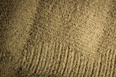 Fine brown river sand close up. Background