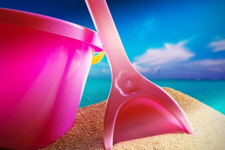 Children's beach toys - buckets and spade on sand