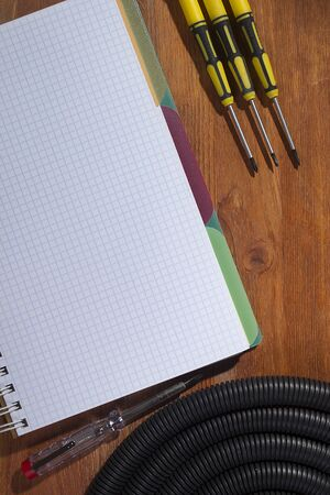 Notebook and electrical accessories on a wooden table