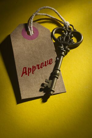 Vintage key with the label and the word approve