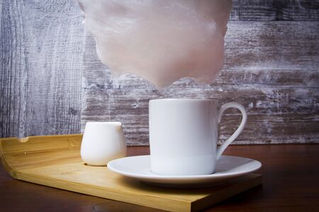 Cotton candy and cup of coffee on a wooden table Reklamní fotografie