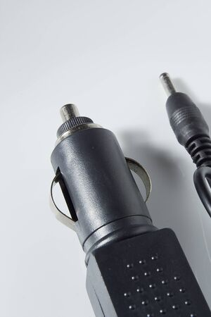 Black car adapter for your mobile phone on white background