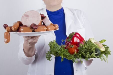 Nutritionist doctor with food plates on white background
