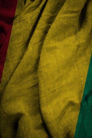 The state flag of coarse fabric Guinea Foto de archivo
