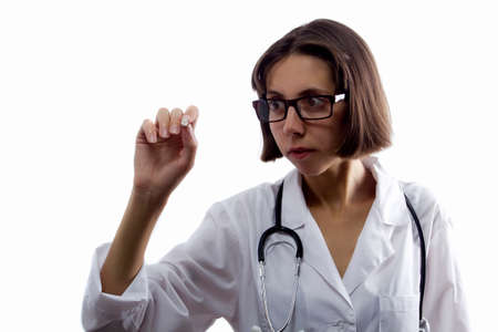 Female medical student with chalk in hand on white background 写真素材