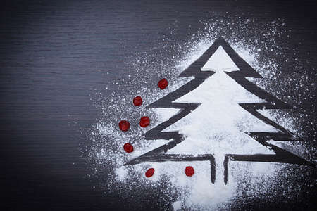 Spruce from flour and candied fruits on a dark table 版權商用圖片