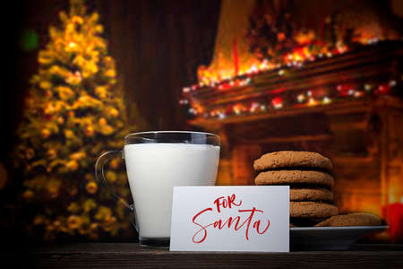 Cookies and milk for Santa near the Christmas tree