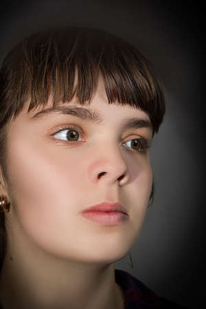 Close up portrait of young beautiful woman on gray background
