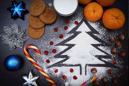 Christmas background with Santa treat and Christmas tree toys